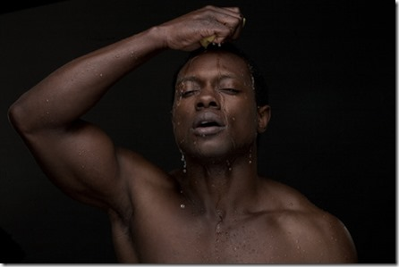 Man Washing Face with Water