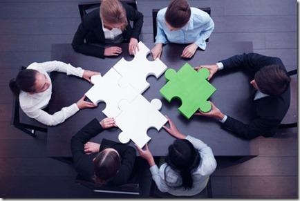 business team solving puzzle